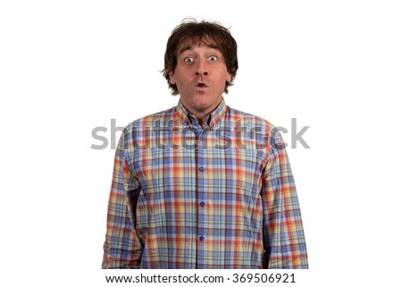 Surprised young man covering mouth isolated on white background.