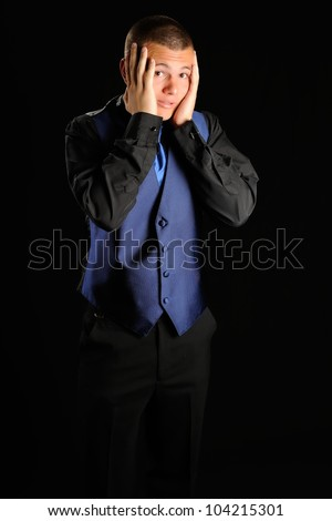 Surprised Young Man. High school student with his hands on his face as if he forgot something important. - stock photo