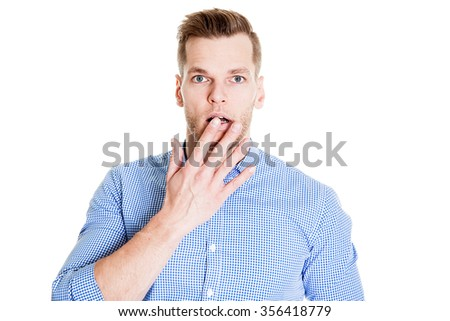 Surprised Young man isolated on white background - stock photo