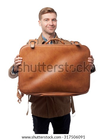 surprised young man with suitcase - stock photo
