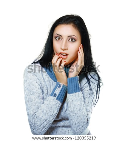 Surprised young pretty woman in winter sweater - stock photo