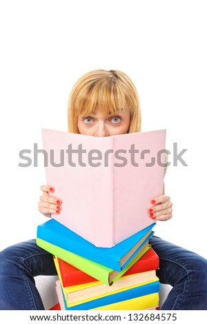 Surprised young student woman with books, isolated on white background