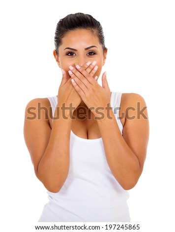 surprised young woman covering her mouth - stock photo