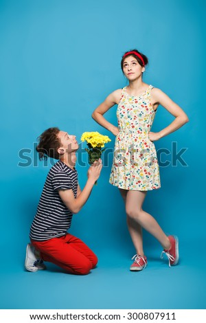 Surprised young woman getting flower from  - stock photo