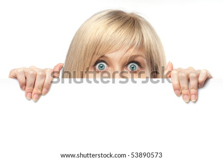surprised young woman holding white empty paper isolated on white - stock photo