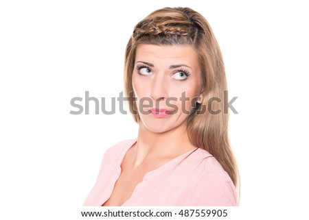 Surprised young woman in front of white background