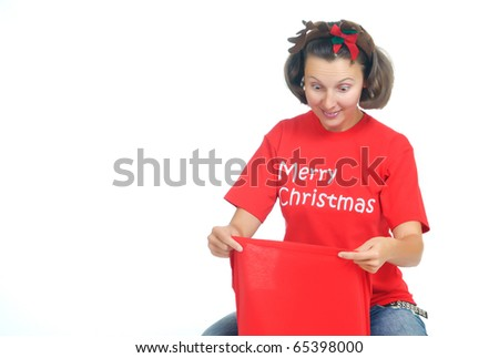 Surprised young woman looks into a Santa's Bag with gifts