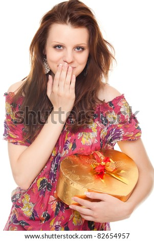 surprised young woman with gift gold box as heart isolated on white background - stock photo