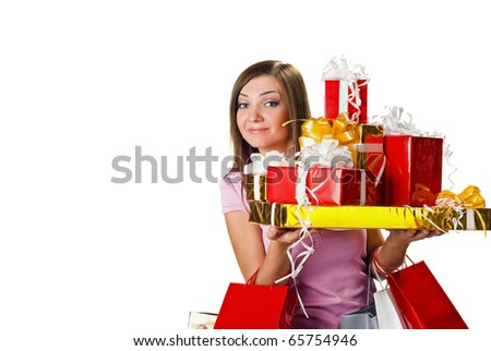 surprised young woman with shopping and gifts. isolated on white