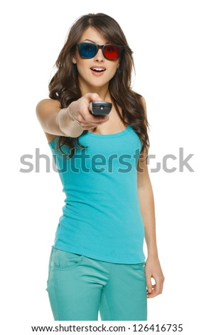 Surprised young woman with TV remote over white background - stock photo
