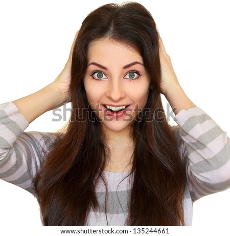 Surprising fun woman with opened mouth and big eyes holding head isolated - stock photo