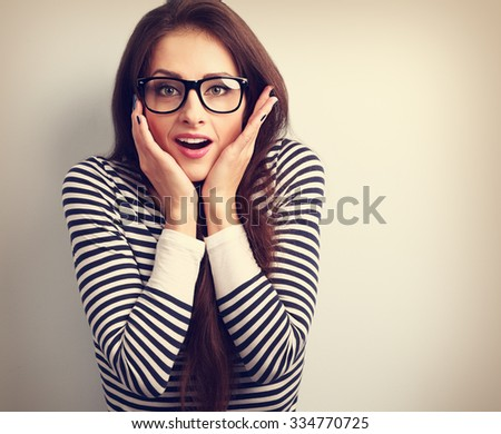 Surprising shocked young casual woman with open mouth. Vintage closeup portrait - stock photo