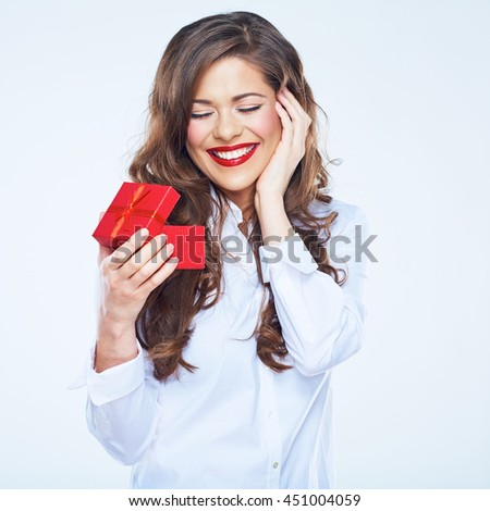 Surprising woman holding little red gift. Curly long hair. Female portrait. - stock photo
