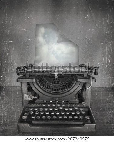 Surreal imagine in black and white of a beautiful classic old fashioned typewriter with a paper with clouds in a vintage style - stock photo