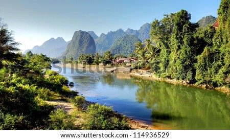 Surreal landscape by the Song river at Vang Vieng, Laos - stock photo