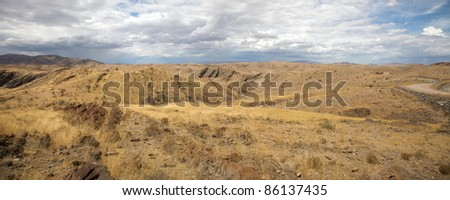 Surreal panorama of the Namib desert going towards Solitaire and Sossusvlei, Namibia. - stock photo