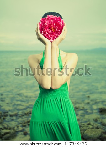 Surreal portrait of a woman with a flower instead of a face - stock photo