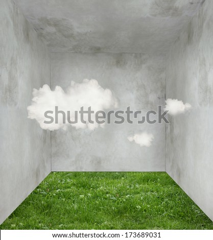 Surreal room with grass on the floor and three clouds inside - stock photo