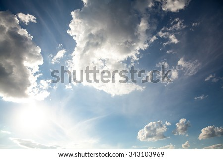 Surreal sun rays are striking through the clouds like an explosion. - stock photo