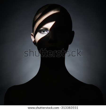 Surrealist portrait of young lady with art makeup - stock photo