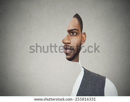 surrealistic portrait front with cut out profile of a young man isolated on grey wall background  - stock photo
