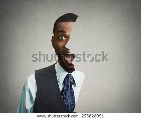 surrealistic portrait headshot front with cut out profile of a young astonished handsome man isolated grey wall background  - stock photo