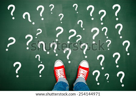 Surrounded by question marks - stock photo