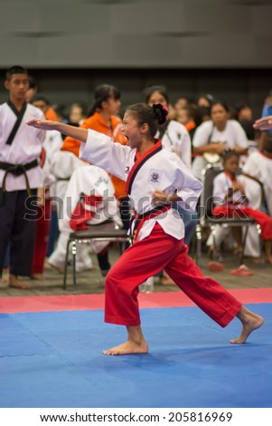 SURTTHANI, THAILAND - JULY 12: Unidentified Thai students 4 - 17 years old in action at suratthani taekwondo championship 2014 on July 12, 2014 in Suratthani, Thailand.