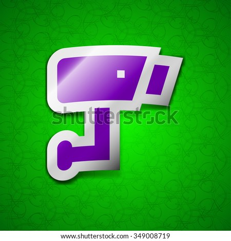 Surveillance Camera icon sign. Symbol chic colored sticky label on green background. illustration - stock photo