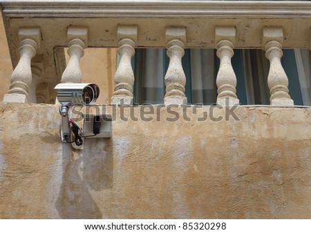 Surveillance camera in the old building - stock photo