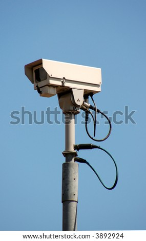 Surveillance Camera mounted on a post.