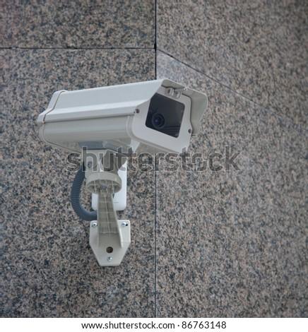 Surveillance camera of office building - stock photo