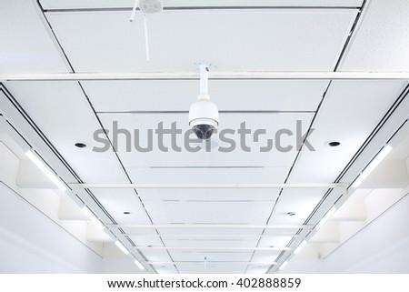 surveillance camera on ceiling - stock photo
