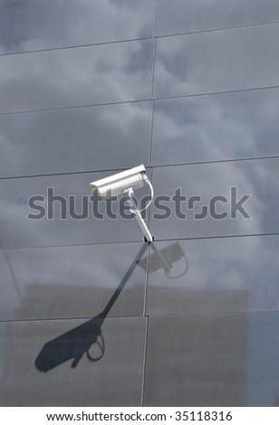 Surveillance camera on facade - stock photo