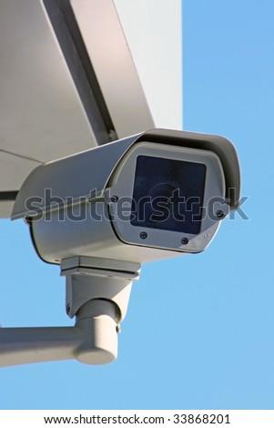 surveillance camera under sky - stock photo