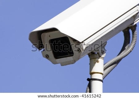 surveillance camera with a blue background - stock photo