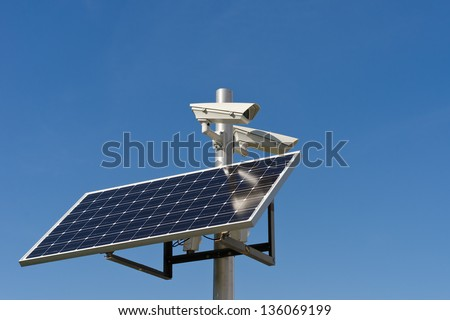 surveillance cameras and photovoltaic panel electrical power supplies are - stock photo