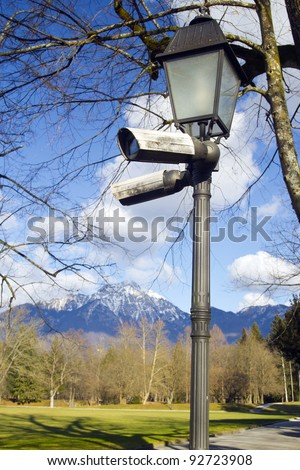Surveillance cameras on a street lamp