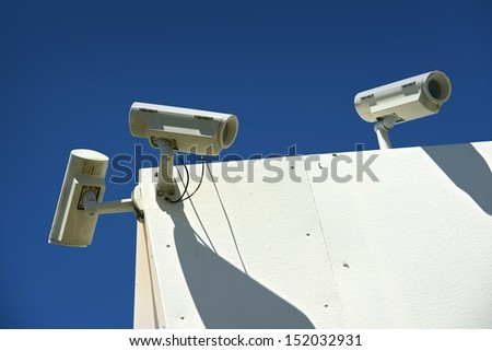 Surveillance CCTV Cameras on the Building Corner. Surveillance Technology. - stock photo