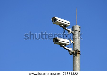 Surveillance Security Camera on blue sky