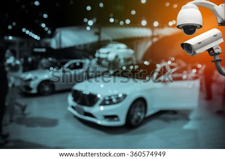 Surveillance Security Camera or CCTV with blurred event background - stock photo