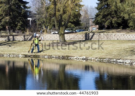 Survey is done! - Carrying the robotic station. - stock photo