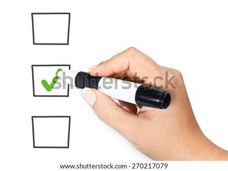 Survey. Male hand checking the checklist boxes isolated on white background - stock photo