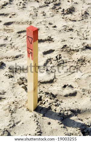Survey mark on building construction site - stock photo