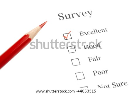 Survey Questionnaire with Red Pencil and Check Mark - stock photo