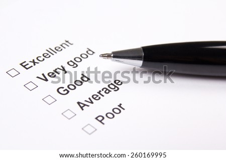 survey with excellent, very good, good, average and poor answers and metal pen - stock photo