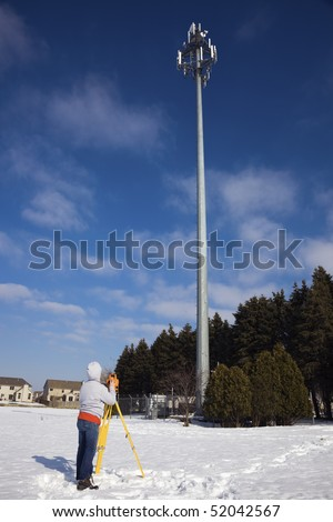 Surveying cellular compound - winter time. - stock photo