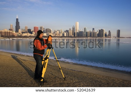 Surveying in Chicago - winter time. - stock photo