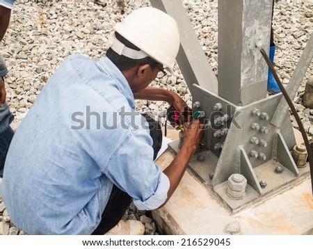 Surveyor engineer on the substation - stock photo