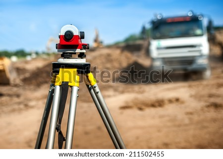 surveyor engineering equipment with theodolite at highway infrastructure construction site - stock photo